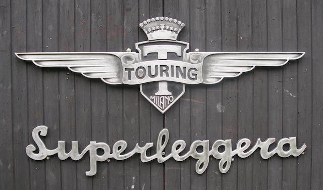 Two garage display emblems for 'Carrozzeria Touring Milano' and 'Superleggera',