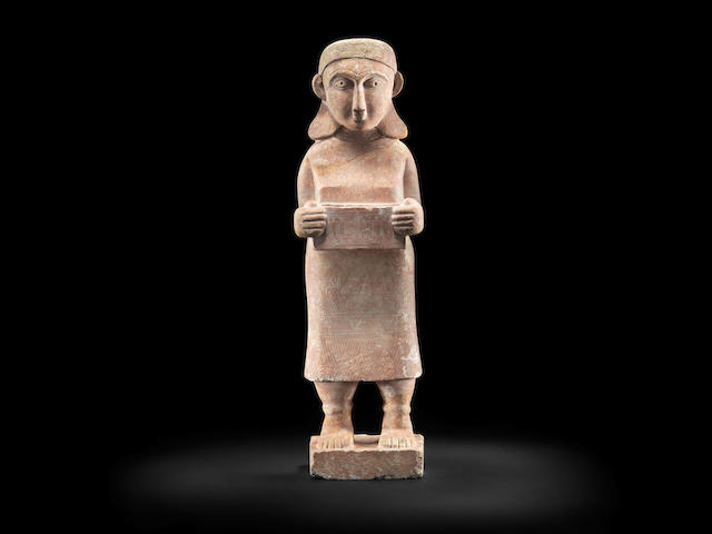 A large South Arabian gesso-painted marble female votive figure