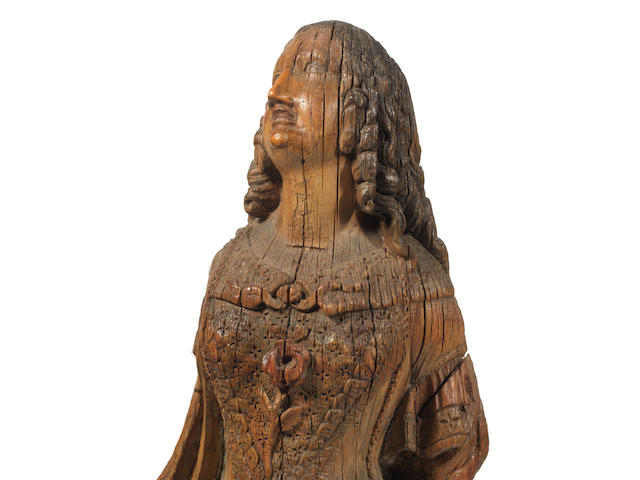 A small finely carved ship's figure head, 35ins.(89cm)high.