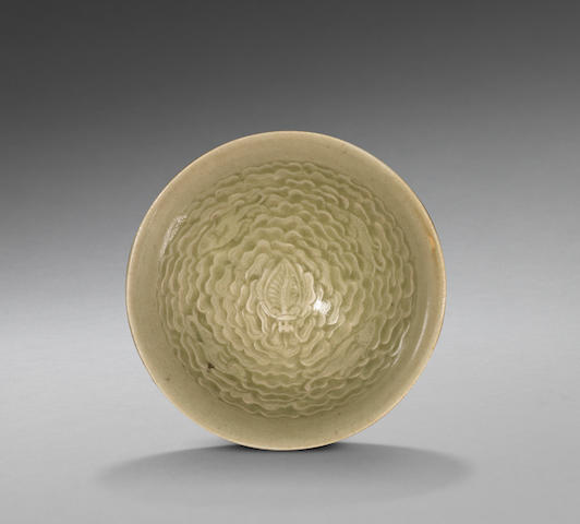A fine small Yaozhou celadon 'four fish' moulded conical bowl Northern Song Dynasty