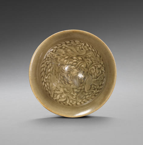 A rare small Yaozhou celadon 'three cranes' moulded conical bowl Northern Song Dynasty