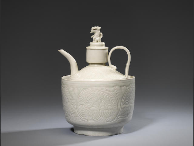 A rare Qingbai carved globular ewer, lion-finial cover and deep warming bowl Southern Song Dynasty