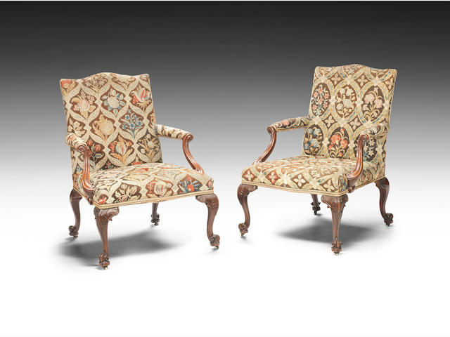 A pair of George III carved mahogany 'Gainsborough' type open armchairsin the French taste (2)