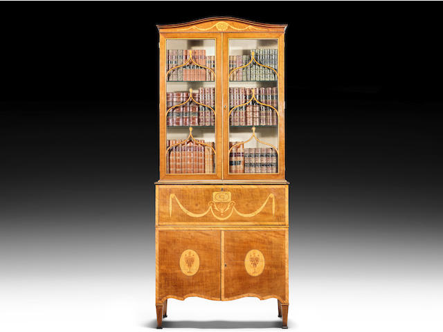 A George III sycamore, kingwood crossbanded and harewood marquetry serpentine secretaire cabinet attributed to Mayhew and Ince