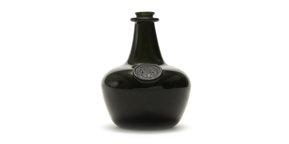 A rare sealed 'transitional' shaft and globe/onion wine bottle, dated 1687
