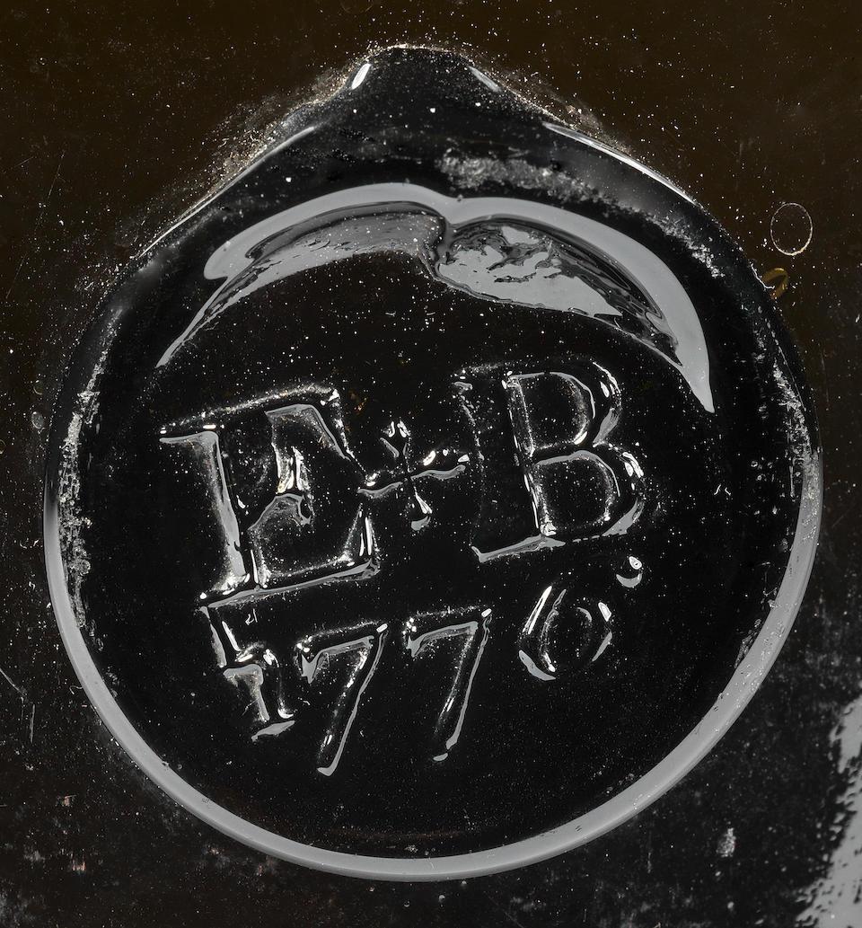 A sealed cylinder wine bottle, dated 1776