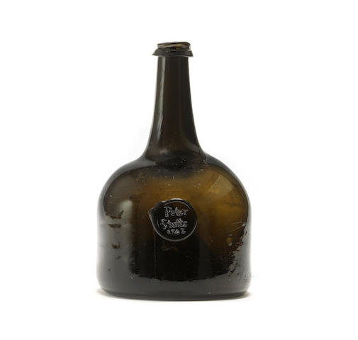 A sealed mallet wine bottle, dated 1742
