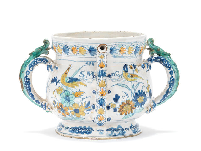An important English delftware polychrome posset pot, dated 1695