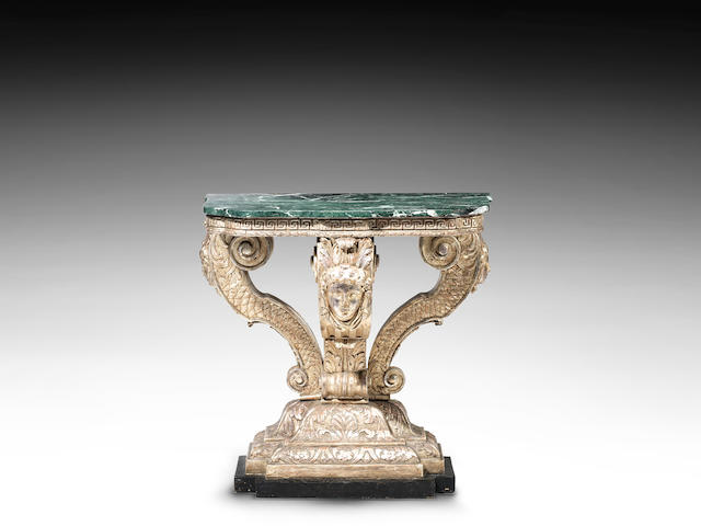 A George I silvered and gilt, carved serpentine console table in the manner of William Kent