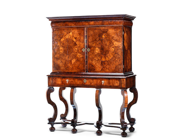A William and Mary kingwood oyster veneered and rosewood cabinet on stand