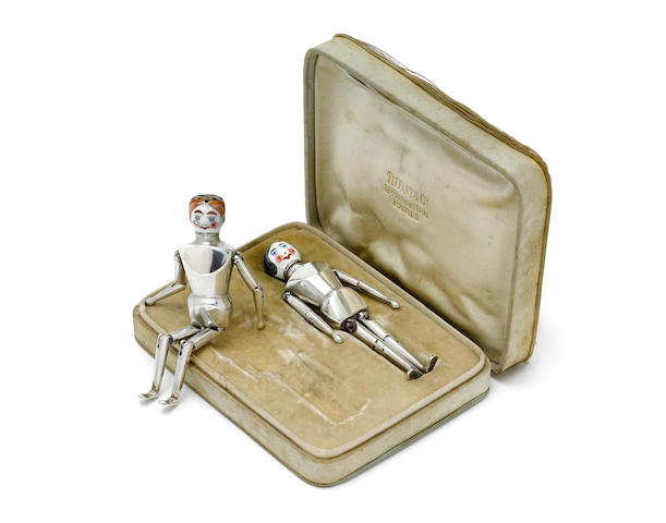 Two cased early 20th century silver and enamelled articulated peppers stamped with French import marks, retailed by Tiffany & Co, also incused stamped reg465792 (2)