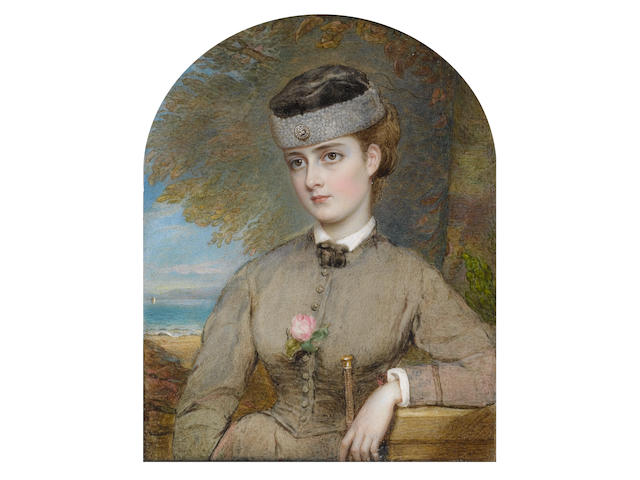 Reginald Easton (British, 1807-1893) Bessie Florence 'Floss' Scarlett née Gibson (1851-1934), standing before a sandy beach and wearing fawn dress over white chemise and brown ribbon tie, a pink rose at her corsage, her light brown hair upswept beneath a brown shearling hat set with a diamond brooch, a cane in her left hand