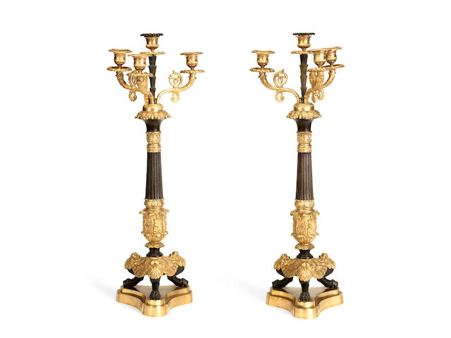 A pair of Restauration Period gilt and patinated bronze four light candelabra (2)