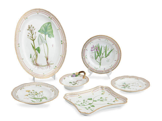A Royal Copenhagen 'Flora Danica' part dinner service and four similar flora danica plates 20th Century