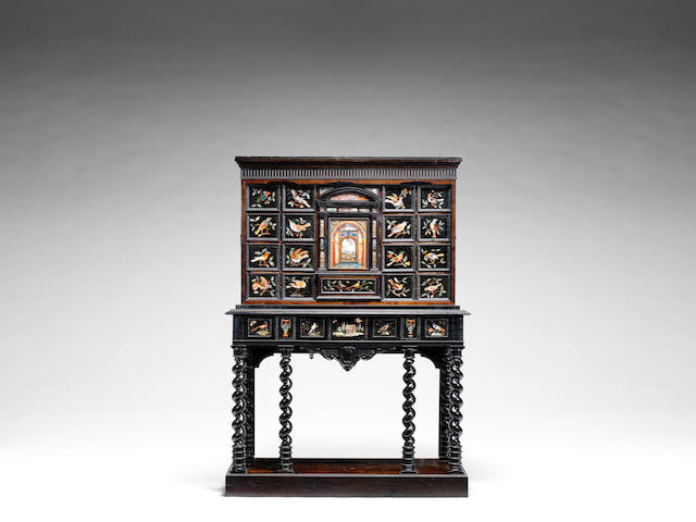 An Italian ebony, ebonised and rosewood cabinet on stand mounted with Florentine 17th/18th century pietre dure plaques the central panel attributed to the Grand Ducal workshops, the cabinet-work 17th century and later