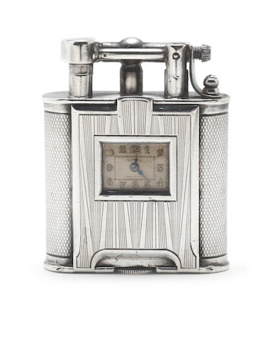 DUNHILL: An Art Deco novelty silver 'Watch Lighter' with French post-1893 import marks, circa 1930, the underside stamped 'ALFRED DUNHILL, PARIS, PAT. NO. 143752'