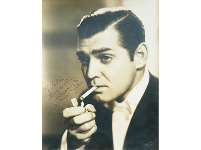 Clark Gable: A large sepia publicity photograph signed by the subject,