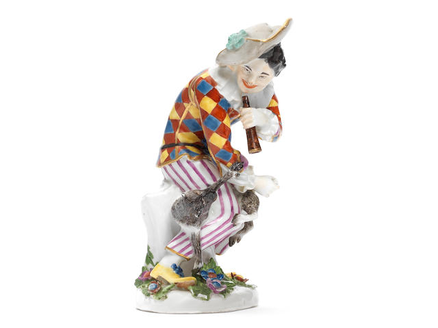 A rare Meissen figure of Harlequin with a monkey, circa 1740