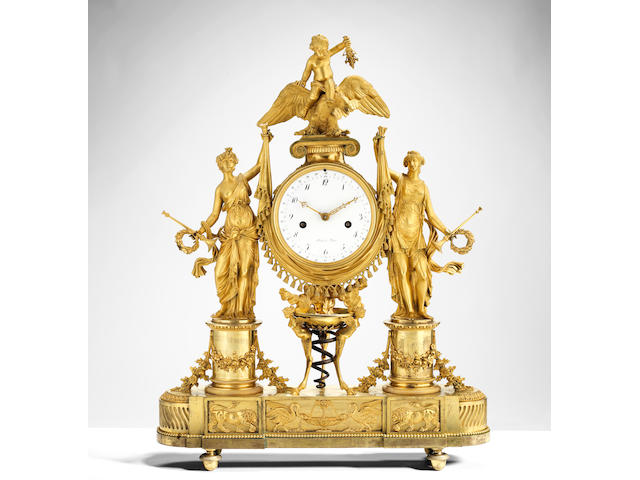 A French 18th century Louis XVI gilt bronze figural mantel clock