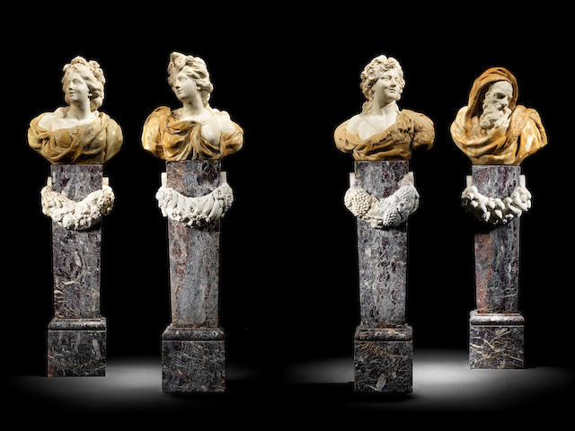 An impressive group of four Italian mid-18th century Giallo di Siena, Broccatello di Siena, Giallo di Verona, white marble and Rosso di Levanto marble busts emblematic of the Four Seasons after the school of Orazio Marinali (4)