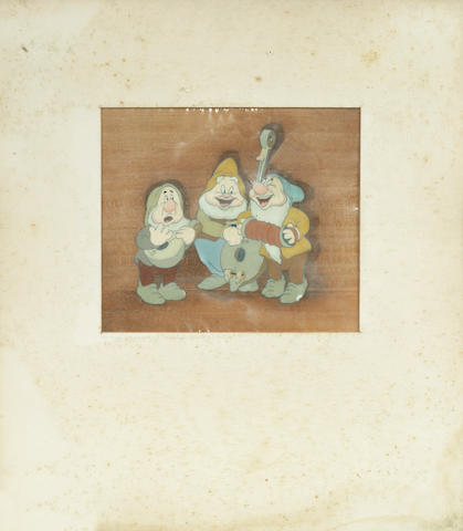 Snow White and the Seven Dwarfs: An original cel of Sneezy, Happy and Bashful playing instruments, Walt Disney, 1937,