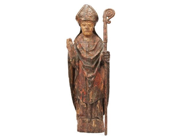 A 16th century polychrome-decorated carved limewood figure, German, of a Bishop saint