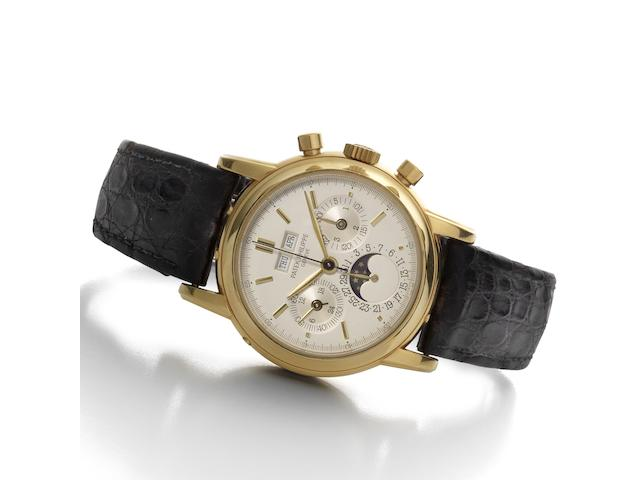 Patek Philippe. A fine and rare 18ct gold manual wind chronograph wristwatch with perpetual calendar and moon phases together with original Certificate of Origin, setting tool and Patek Philippe box  Ref:3970E, Movement No.875693, Circa 1996