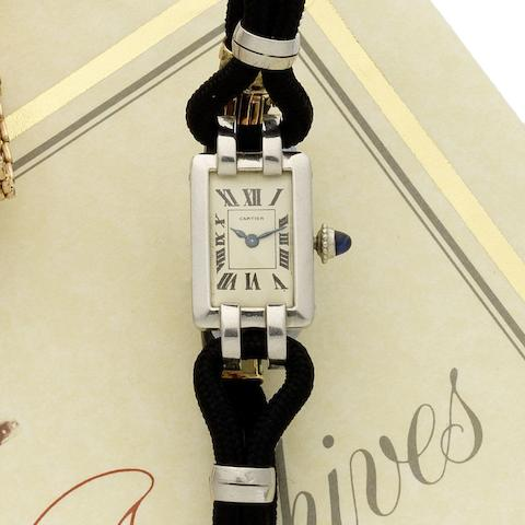 Cartier. A fine and rare platinum and 18ct gold manual wind wristwatch with gold and enamel deployant clasp  Circa 1925