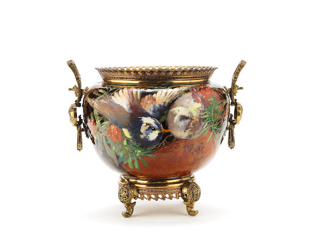 A late 19th century French gilt bronze mounted faience jardiniere in the Japonisme taste