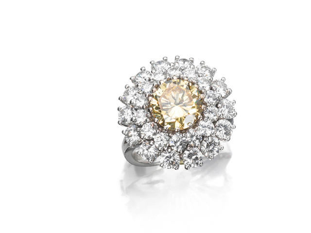 A fancy-coloured diamond cluster ring