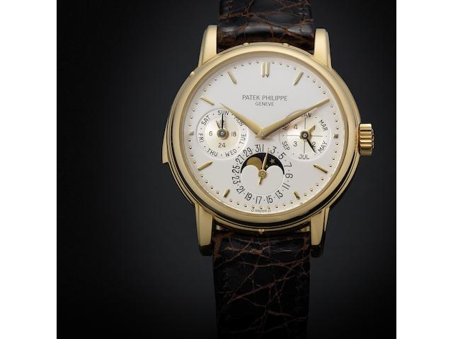 Patek Philippe. A fine and rare 18ct gold automatic perpetual calendar minute repeating wristwatch with moon phase together with fitted box and original Certificate of Origin Ref:3974/J, Case No.2865066, Movement No.1906007, Sold 6th October 1989