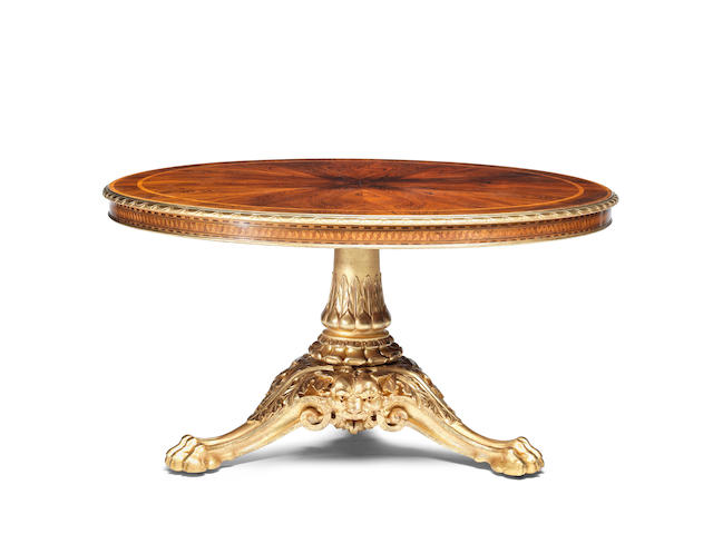 An early Victorian giltwood, rosewood, tulipwood crossbanded, purplewood and parquetry centre table