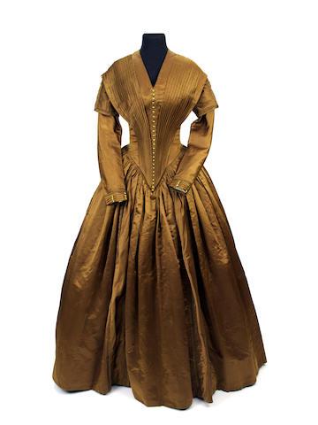 An 1840s bronze silk satin day dress