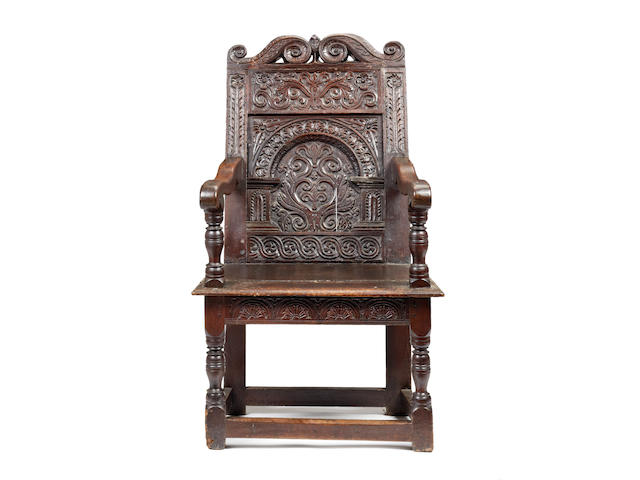 A rare and impressive James I oak panel-back open armchair, Somerset, circa 1625