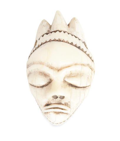 A Pende ivory pendant, ikhoko Democratic Republic of Congo 5.5 x 3.5cm (14 x 9ins)
