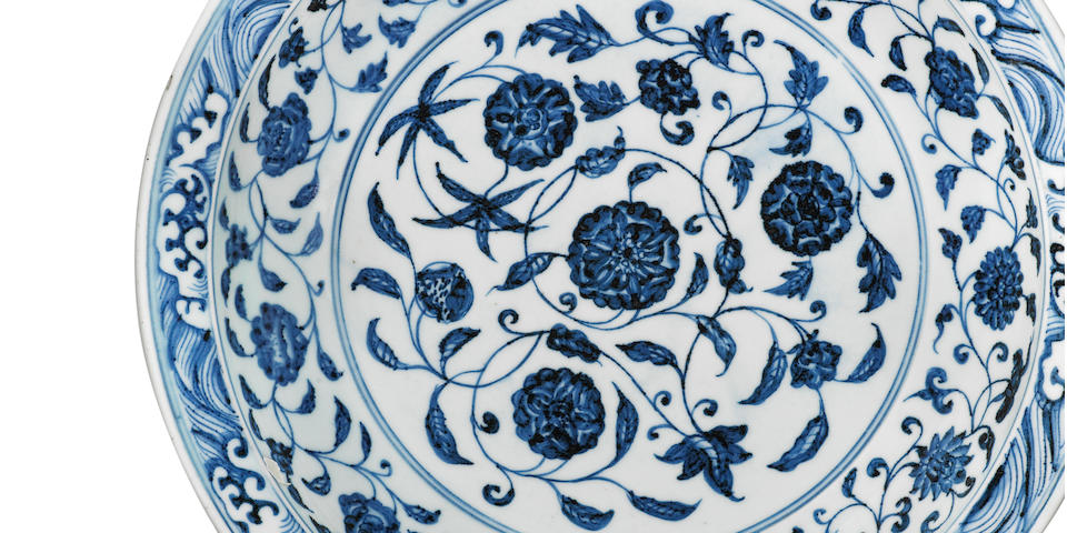 A rare large blue and white 'floral scroll' dish Yongle