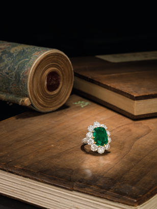 An important emerald and diamond cluster ring