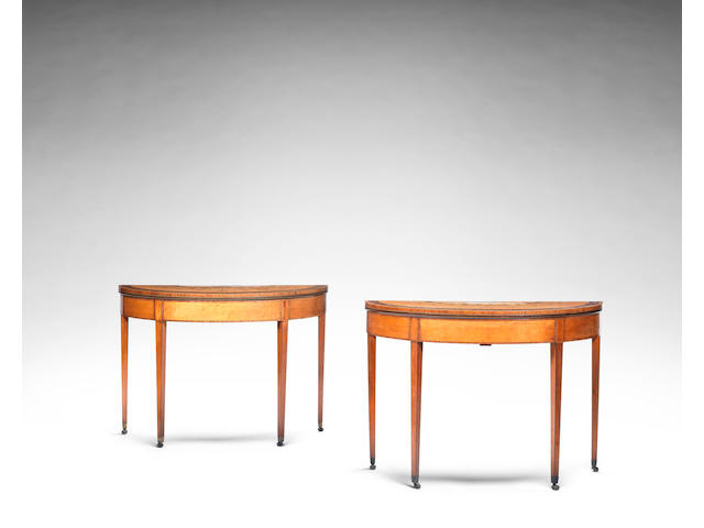 A pair of George III satinwood,  harewood,sycamore, amaranth and tulipwood banded demi lune card tables    (2)
