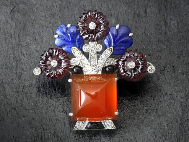 A gem-set and diamond brooch, by Cartier,