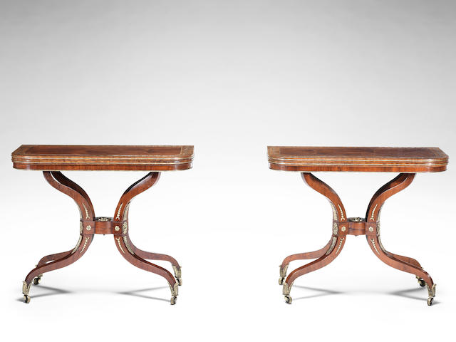 A pair of Regency rosewood, crossbanded and brass inlaid card tables (2)