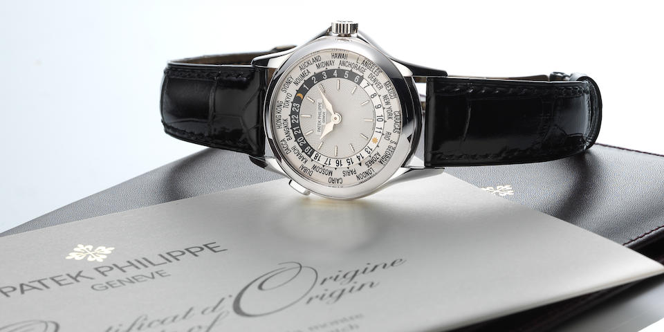 Patek Philippe. An 18K white gold automatic world time wristwatch Ref:5110G, Case No.4102980, Movement No.3207127, Sold 25th October 2001