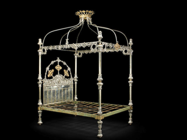 An impressive Victorian silver coloured metal and parcel-gilt bed attributed to R.W.Winfield