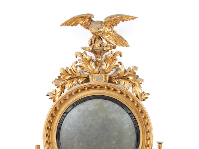 An impressive early 19th century carved giltwood wall mirror
