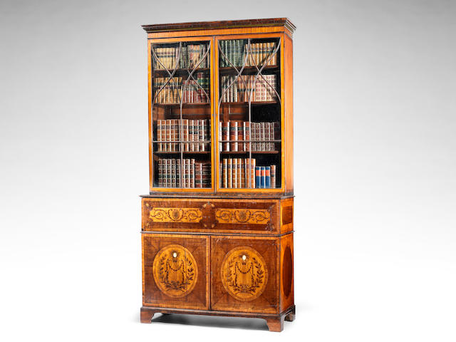 A George III satinwood and sycamore marquetry secretaire bookcase in the manner of Mayhew and Ince