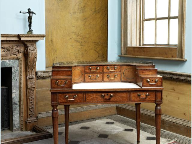 A small late George III satinwood, rosewood and tulipwood crossbanded and painted Carlton House desk