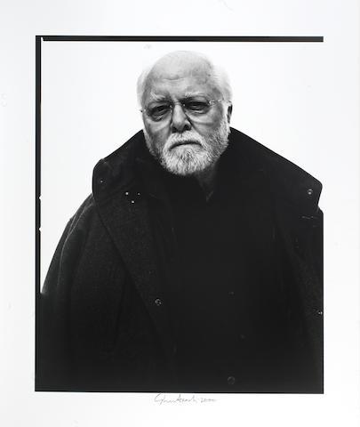 A black and white portrait photograph of Richard Attenborough,