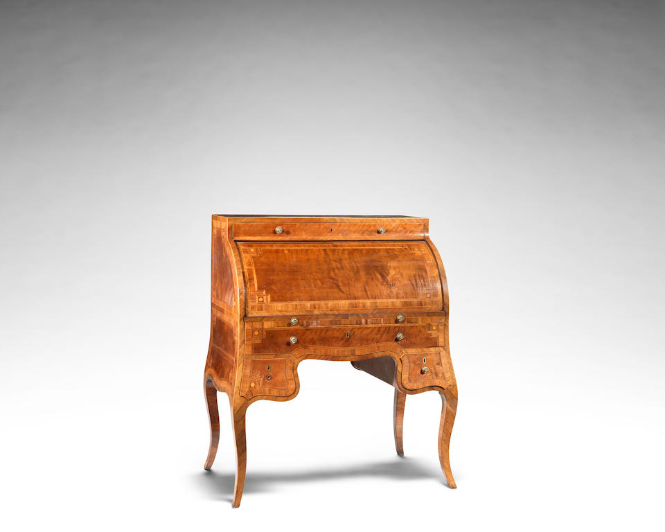 A George III mahogany and inlaid cylinder bureau in the manner of William Moore of Dublin