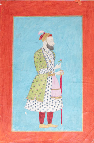 A nobleman, perhaps Nasir Jang, standing holding a sword and a flower Deccan, 18th Century