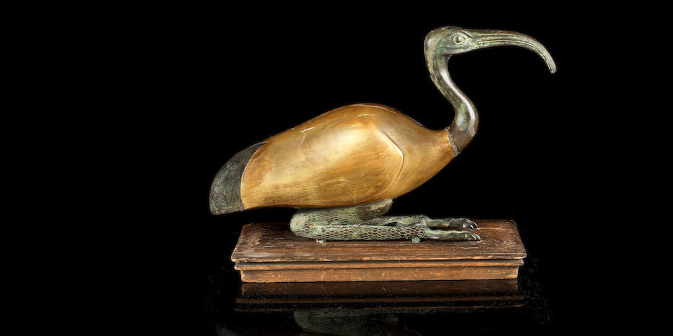 An Egyptian bronze and gilt wood ibis