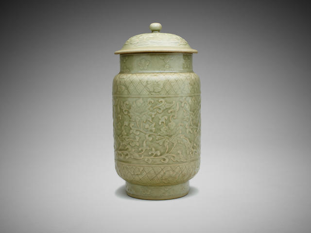 A Chinese celadon-glazed moulded 'scrolling lotus' cylindrical vase with cover
